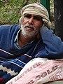 Man outside Pilgrim's Market - Lumbini Development Zone - Lumbini - Nepal (13848589433).jpg