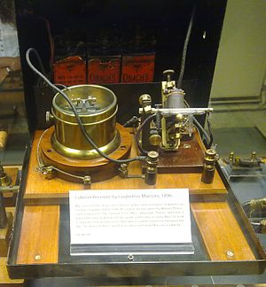 Coherer - Marconi's 1896 coherer receiver, at the Oxford Museum of the History of Science, UK.  The coherer is on right, with the decoherer mechanism behind it. The relay is in the cylindrical metal container (center) to shield the coherer from the RF noise from its contacts.