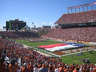 Texas Longhorns football - Darrell K Royal–Texas Memorial Stadium with a view of the Godzillatron