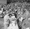Men of 6th Battalion, the Green Howards receive 48-hour ration packs before embarking onto landing ships during Exercise 'Fabius', 5 May 1944. H38222.jpg