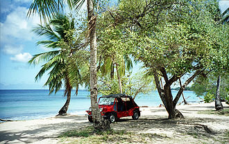 Speightstown - A Mini Moke rental car on a Speightstown beach (1995).