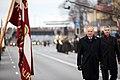 Ministru prezidents Valdis Dombrovskis vēro Nacionālo bruņoto spēku vienību militāro parādi 11.novembra krastmalā (6357746843).jpg