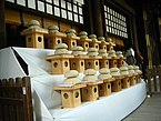 Mochi offerings by SaddaGocaraRupa at Meiji Jingu.jpg