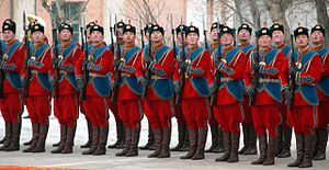 Mongolian General Purpose Force - An honor guard salutes during the welcoming ceremonies for Air Force General Richard B. Myers, who became the first Chairman of the Joint Chiefs of Staff to visit Mongolia, January 13, 2004.