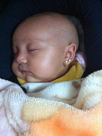 Earring - Newborn baby girl with triple ear piercings – Costa Rica 2012.