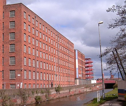 Old and Decker Mills standing above the canal. Doubling Mill is also visible to the rear. MurraysMillsOldDeckerMill.jpg