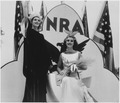 NRA-posed shot of two woman dressed in costumes promoting National Recovery Administration programs with blue eagle... - NARA - 197272.tif