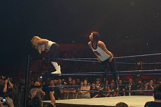 Natalya Neidhart - Natalya (left) along with Victoria (on ropes) during a house show in 2008