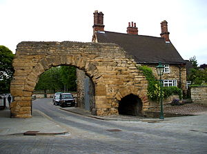 Postern - The postern of Newport Arch, built by the ancient Romans in Lincoln, England, located to the right of the larger main arch, and used for pedestrian traffic