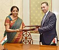 Nirmala Sitharaman and the Minister Trade and Industry, Jordan, Mr. Yarub Qudah exchanging after signing the Minutes of 10th session of India-Jordan Trade Agreement, in New Delhi.jpg