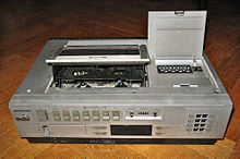 Videocassette recorder wikipedia top loading cassette mechanisms such as the one on this vhs model were common on early domestic vcrs publicscrutiny Choice Image