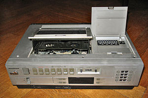 Videocassette recorder - Top-loading cassette mechanisms (such as the one on this VHS model) were common on early domestic VCRs.