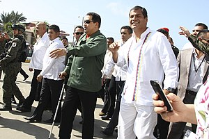Death of Hugo Chávez - Chávez walking with a cane accompanied by Rafael Correa in Caracas in July 2011, shortly after his first cancer surgery.