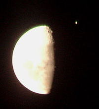 Jupiter (the bright object in the upper right) a few minutes before being occulted by the Moon on June 7, 2005