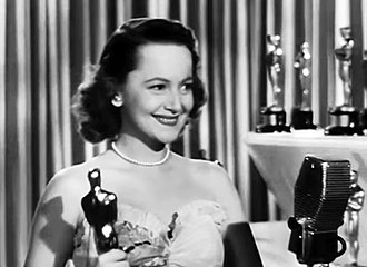 Olivia de Havilland - Olivia de Havilland with the first of her two Oscars, this one for To Each His Own, March 13, 1947