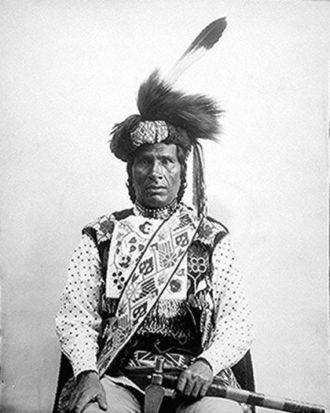 "Bandolier bag - ""One Called From A Distance"" (Medwewinind) of the White Earth Band, 1894. He is shown here wearing a Bandolier bag, with the strap across his chest."