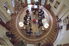 The Oval Office from above in 2001, during the administration of George W. Bush. President Bush chose a more somber color palette than his predecessor, using shades of taupe, celadon and navy. The president and Mrs. Bush worked with interior decorator Ken Blasingame on the design of the office.
