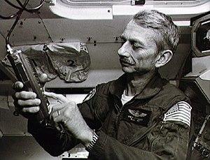 Owen K. Garriott - Garriott with ham radio during STS-9 training in 1983
