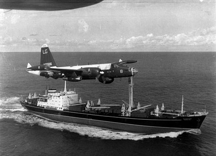 A US Navy P-2H Neptune of VP-18 flying over a Soviet cargo ship with crated Il-28s on deck during the Cuban Crisis. P-2H Neptune over Soviet ship Oct 1962.jpg