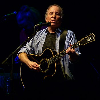 Three-time winner Paul Simon won twice as the main credited artist in 1976 and 1987 Paul Simon at the 9-30 Club (b).jpg