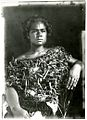 Photograph (black and white); portrait of woman sitting on a western-style chair, wearing a plant fibre top; Oceania. Gelatin silver print. Oc,B130.62, British Museum.jpg