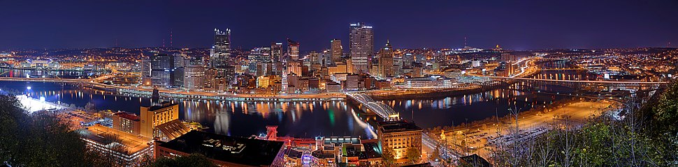 Pittsburgh seen from Mt. Washington at night in 2015, with the Monongahela River in the foreground.