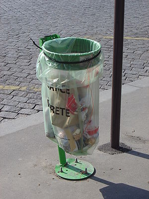A public waste bag  in Paris displaying the in...