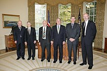 President George W. Bush meets with the 2005 Nobel Prize recipients, Tuesday, Nov. 8, 2005 in the Oval Office at the White House.jpg