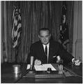 "President Lyndon B. Johnson signs ""Gulf of Tonkin"" resolution - NARA - 192484.tif"