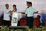 President Rodrigo Duterte, assisted by Defense Secretary Delfin Lorenzana, attaches the presidential banner to the flag of the Best Squadron winner.jpg