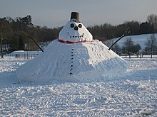 Photograph of a giant snowman with conical base in South Nutfield, Surrey, England