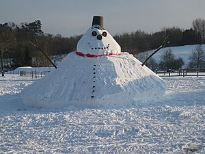 Snowman - Larger style of snowman with conical base. The angle of repose of a piled substance may be an aspect of snowman building at this size, depending on the properties of the snow and the method of construction.