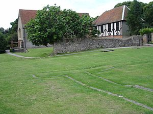 Prittlewell Priory - The remains of Prittlewell Priory in Essex, showing the marked layout of the priory church in the foreground and claustral buildings in the background
