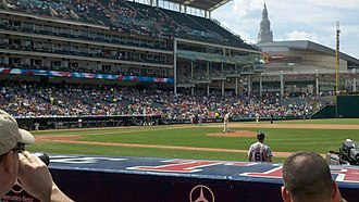 Progressive Field - A view from the lower deck, with Quicken Loans Arena and the Terminal Tower in the background. The Terrace Club is behind the windows to the left of the foul pole.
