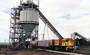 Goonyella railway line - QR loco 1740 hauls a special train through a coal loading facility, Goonyella line
