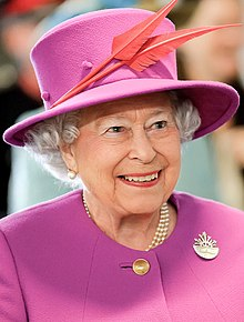 A photograph of Queen Elizabeth II; she appears happy.