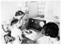 Queensland State Archives 2986 A School of the Air primary student in regional Queensland takes class via two way radio c 1960.png