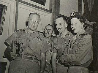 North-Eastern Area Command - Air Commodore Summers (left), who succeeded Air Commodore Cobby as AOC North-Eastern Area Command, with staff in Townsville, May 1944