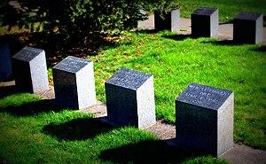 RMS Titanic Graves 215 244 302 298 in Mount Olivet Cemetery.jpg