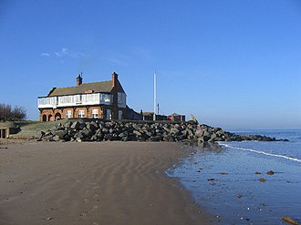 Brancaster - RWNGC clubhouse at high tide