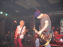 Rancid live in 2006. Pictured are Lars Frederiksen, Tim Armstrong and Brett Reed (back)