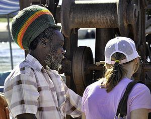 Culture of Jamaica - A Rastafarian man in a rastacap at a port of Jamaica's Black River.