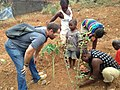 Real African people working on their little farm in Freetown (They are harvesting potatoes for living ).jpg