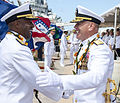 Rear Adm. Frank L. Ponds, left, shakes hands with Rear Adm. Richard L. Wiliams Jr. (9262079855).jpg