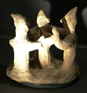 Music of Cyprus - Cypriot terracotta figurine, 750–600 BC, depicting a double aulos player and two dancers. Kunsthistorisches Museum, Vienna.