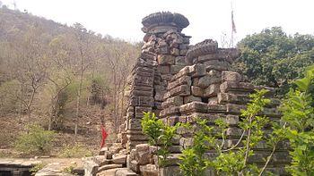 Rock-cut structure around mountains.jpg