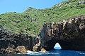 Rock tunnel in Aorangaia Island.jpg