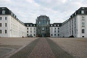Platz des Unsichtbaren Mahnmals - The invisible memorial in front of the castle.
