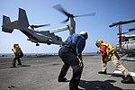 Sailors land an MV-22 Osprey on the flight deck of the USS Bonhomme Richard. (29188465416).jpg