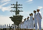 Sailors man the rails aboard USS Dwight D. Eisenhower. (35479860781).jpg